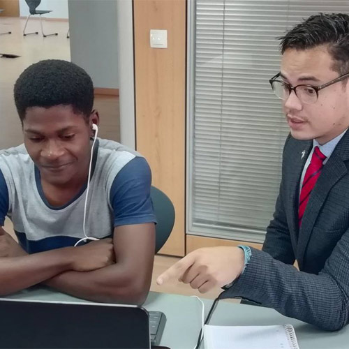 Teacher Helping student with technology based course